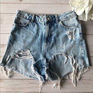 Topshop • High waisted distressed mom jean shorts